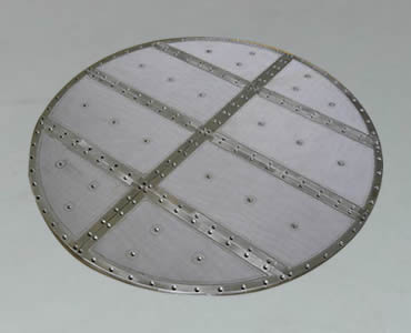 A round sintered filter manufactured with aluminum frame.