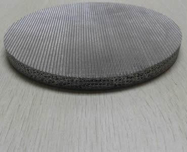 One sintered filter made of black wire cloth in the surface.
