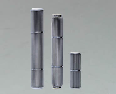 Three candle filters with different length and each filter fastened by metal ring.