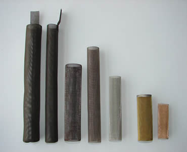 Seven different kinds and materials of cylindrical filters stand on the white background.