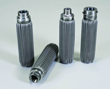 Four cartridge filters made of pleated stainless steel wire mesh.