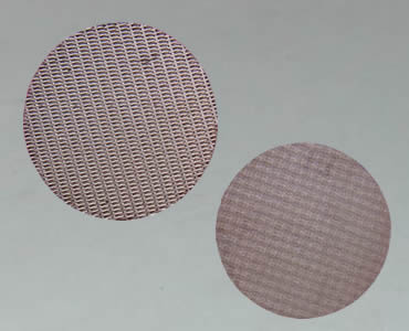 Two round sintered filters discs made of copper mesh.