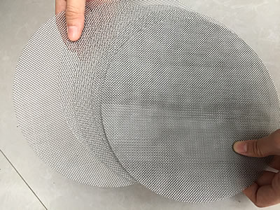 Several same size round stainless steel filter discs.