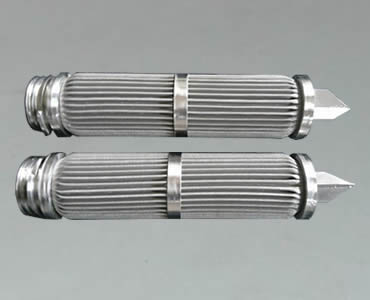 Two candle filters with sharp bottom and in the middle fastened by a metal ring.