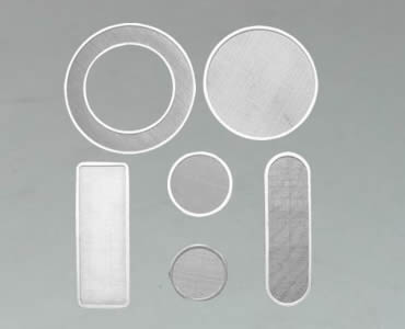 Several filter discs manufactured with different shapes.