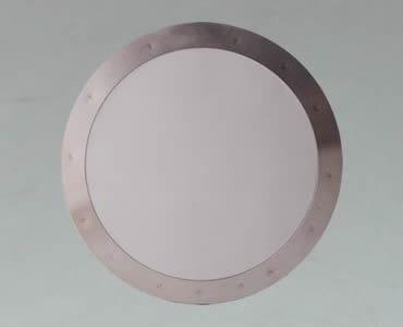 The filter disc made of woven wire mesh with aluminum framed edge.